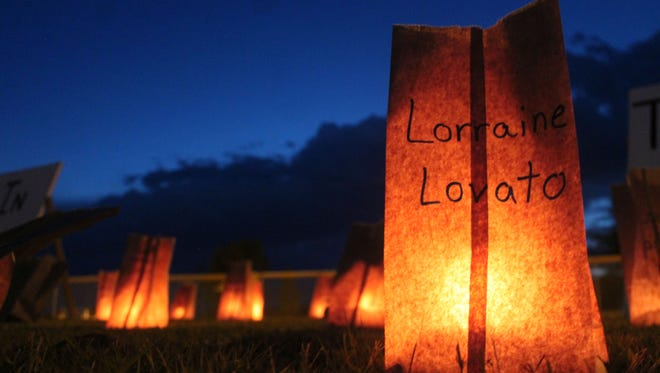 A luminaria for Lorraine Lovato lights up the Tularosa Little League Field on Saturday night. The luminaria was one of 700 lit in honor of community members that had died from cancer.