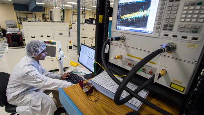 A technician tests logic devices at the GlobalFoundries fab in Essex Junction on Monday, July 31, 2017.