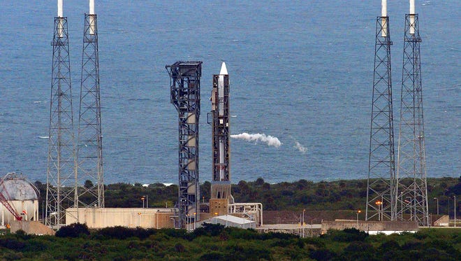 An Atlas V rocket sits on the pad at Cape Canaveral Air Force Station Launch Complex 41 on Friday, Dec. 4, 2015.