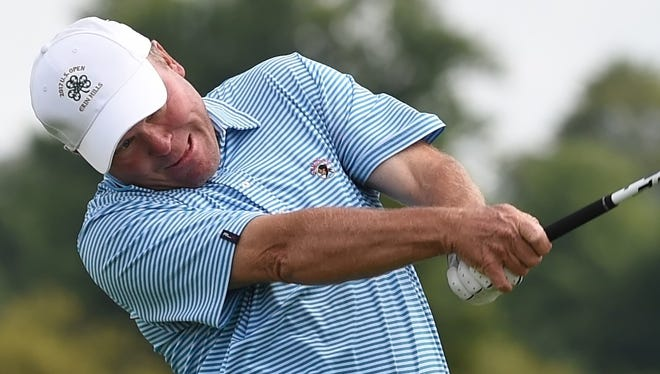 Brent Hofman grimaces as he powers the ball off the ninth tee in the Men's City Tournament at Kampen.