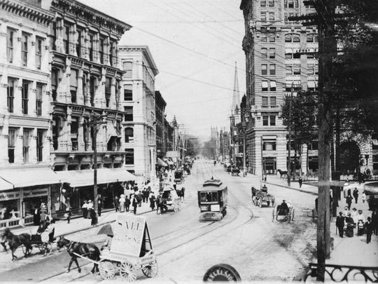 Court Street in Binghamton around 1910, with a trolley and cart in the street.