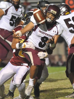 Independence's Jeremy Mitchell loses control of the ball against Tulare Union during their football game at Bob Mathias Stadium on Friday.