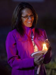 Ellen Hensley conducts a candlelight vigil in remembrance