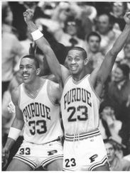 Todd Mitchell, left, and Troy Lewis celebrate a big