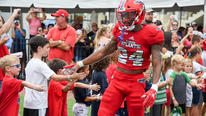 Florida Atlantic safety Zyon Gilbert interacts with fans before a 28-13 victory at FAU Stadium on Oct. 12, 2019. Gilbert is one of the key returners in FAU's secondary.
