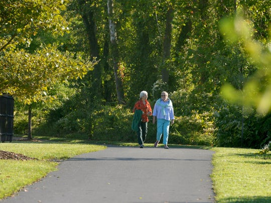 Pat Grabowski and Julie Moyer share conversation as they walk together along the South River Greenway in Waynesboro. Pat Grabowski and Julie Moyer share conversation as they walk together along the South River Greenway in Waynesboro last summer. The two friends walk the path together daily.