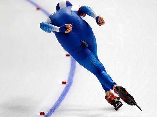 South Korea's Lee Seung-hoon competes during the men's 10,000 meters speedskating race at the Gangneung Oval at the 2018 Winter Olympics in Gangneung, South Korea, Thursday, Feb. 15, 2018. (AP Photo/John Locher)