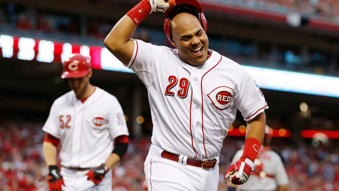 The Reds' Brayan Pena after scoring during a game against the Cardinals at GABP on May 24.