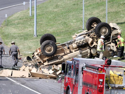 Emergency crews work at the scene of a fatal accident involving a military vehicle on southbound Interstate 95 at the ramp for Interstate 287 in Rye Aug. 6, 2014.