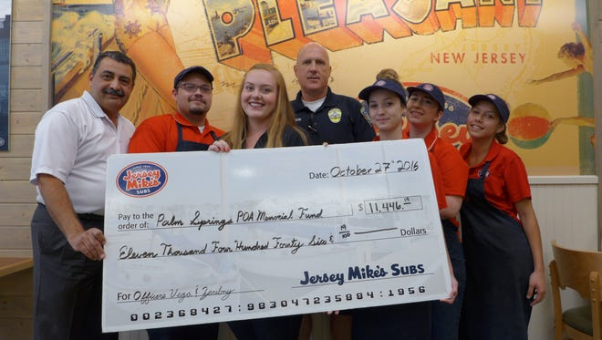 Jersey Mike's staff presents $11, 460 check to Palm Springs Police Officers Association for the families of fallen officers Zerebny and Vega.