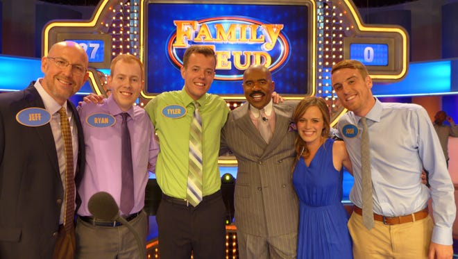 """The Smaha family on the set of """"Family Feud"""" with comedian Steve Harvey."""