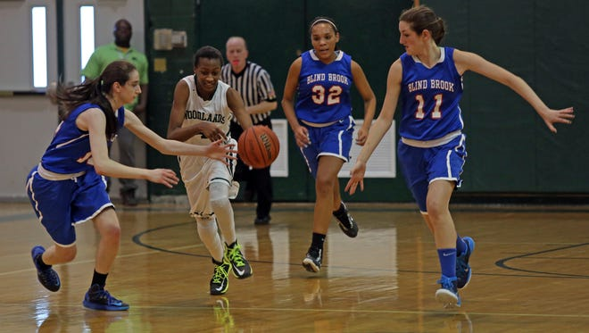 Woodlands defeated Blind Brook 52-40 during the Section 1 Class B first round of girls basketball at Woodlands High School Feb. 12, 2015. .