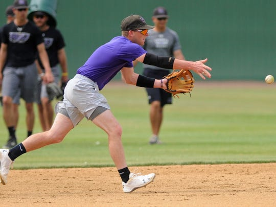 Hardin-Simmons senior shortstop Taylor Cooling flips to second base during a double play drill at the Cowboys' practice on Wednesday, May 2, 2018. Earlier this season Cooling broke the HSU school record for doubles in a career and now has 56 entering the American Southwest Conference tournament on Friday in Alpine.