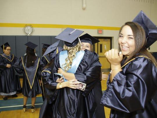 Littlestown Senior High School students attend graduation in Littlestown on Friday.