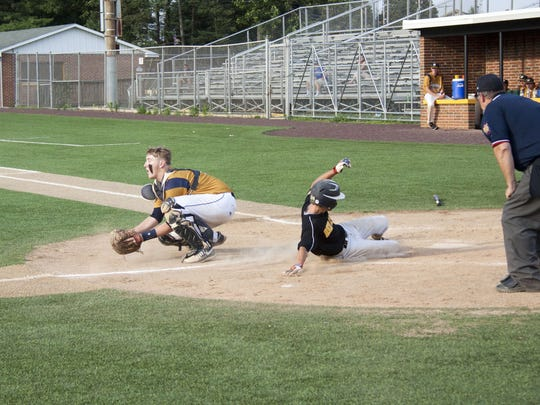 Red Lion's C.J. Czerwinski slides into home to score a run during a first-round American Legion playoff game against Hanover Thursday at Horn Field.