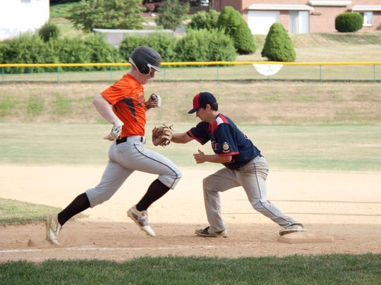 Northeastern's Jonah Latshaw runs to first in the York Adams American Legion championship game Wednesday.