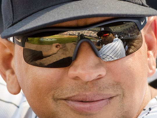Yankees special advisor Alex Rodriguez speaks with CC Sabathia, who is  reflected in A-Rod's sunglasses, ahead of a spring training baseball game against the Philadelphia Phillies, Friday, Feb. 24, 2017, in Tampa, Fla.