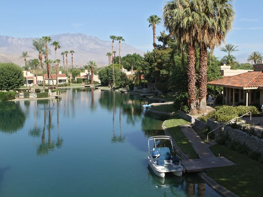Homes face an artificial lake at the Lake Mirage Racquet Club in Rancho Mirage.