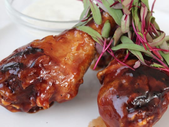 Pollo asado drumsticks ($12) at Vermuteria 600, 600 S. 6th St., are smoked, roasted and glazed with a root beer barbecue sauce.
