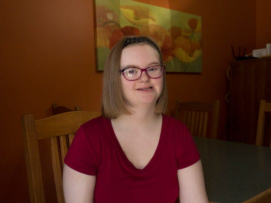 Alyssa Patrias, 20, is all smiles at her kitchen table for a portrait on Friday, September 9, 2017 in Taylor. Patrias became the first woman in the state of Michigan with Down syndrome to compete in a Miss Michigan preliminary pageant. She didn't win the crown, but her pageant sisters voted her to win Miss Congeniality.