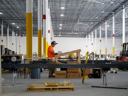 A crew member works on the assembly line at Amazon's