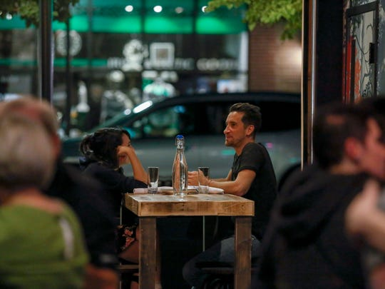 Christina Bennett of Detroit, left, chats with Dave Blazevski, of Berkley, during their first time to Berkley Common on Tuesday, Oct. 3, 2017 in Berkley. Berkley Common recently opened their doors and is located on 12 Mile Rd. and Griffith Ave. in Berkley.