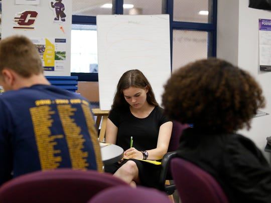 Senior Juliet Christin, 17, takes notes during a discussion with University of Michigan admissions counselor, Mikhaella Norwoord on Thursday, Oct. 5, 2017 at Ferndale High School.