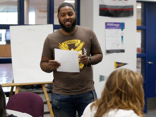 Daniel Lewis, a graduate student at Oakland University, speaks to his class at Ferndale High School on Thursday, Oct. 5, 2017 in Ferndale.