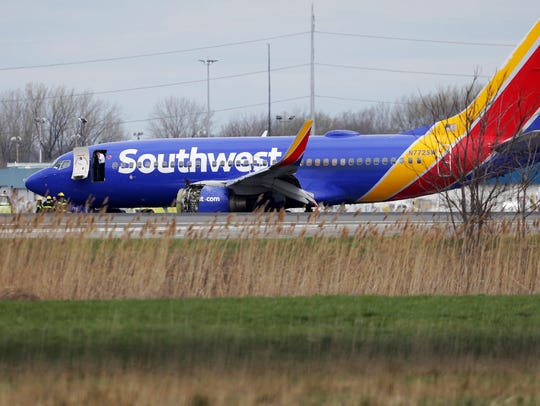 A Southwest Airlines plane sits on the runway at the