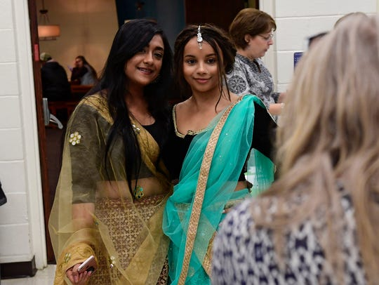 Sophomore Aashka Patel, left, in a dress from India,