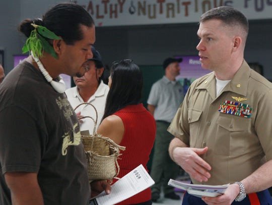 Saipan resident John Castro speaks with Marine Maj.