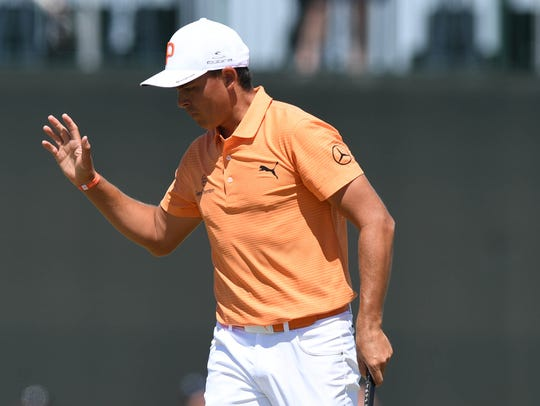 Rickie Fowler reacts after playing the 13th hole during