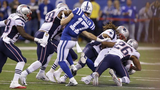 Indianapolis Colts wide receiver Griff Whalen (17) watched Oct. 18, 2015, as Colts free safety Colt Anderson (32) is tackled by New England Patriots running back James White (28) on a fake punt in the second half of an NFL football game in Indianapolis.
