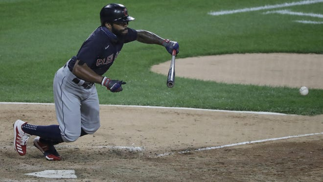 Indians outfielder Delino DeShields puts down a sacrifice bunt in the 10th inning against the Chicago White Sox on Sunday night. The bunt scored Jose Ramirez from third with the go-ahead run in a 5-4 Indians win.