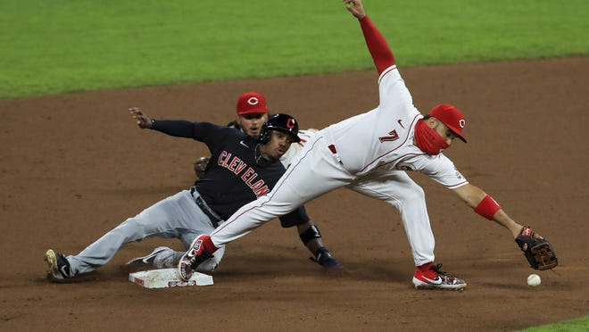 Cleveland Indians' Greg Allen (1) is safe at first as Cincinnati Reds' Eugenio Suarez (7) is unable to field the ball during a baseball game at in Cincinnati, Monday, Aug. 3, 2020. The Reds won 3-2.