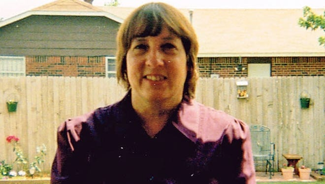 In this photo provided by the family of Colleen Hufford, Hufford is pictured in the backyard of her home in Moore, Okla.