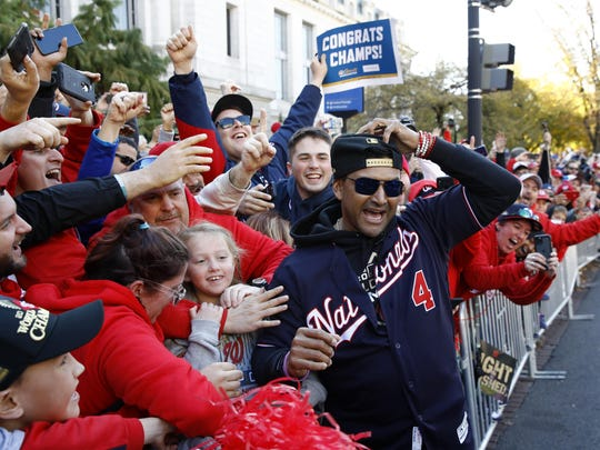 In this Nov. 2, 2019 photo, Washington Nationals manager Dave Martinez celebrates with fans during a parade to celebrate the team's World Series baseball championship over the Houston Astros in Washington.