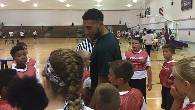 """Denzel Valentine talks to some of his campers Monday. """"I like these kids,"""" he said. """"They come here and work hard and do everything the right way."""""""