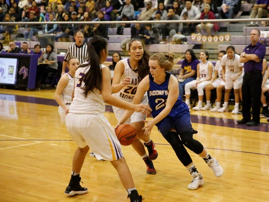 Bloomfield's Halle Payne, No. 21 in blue, drives toward