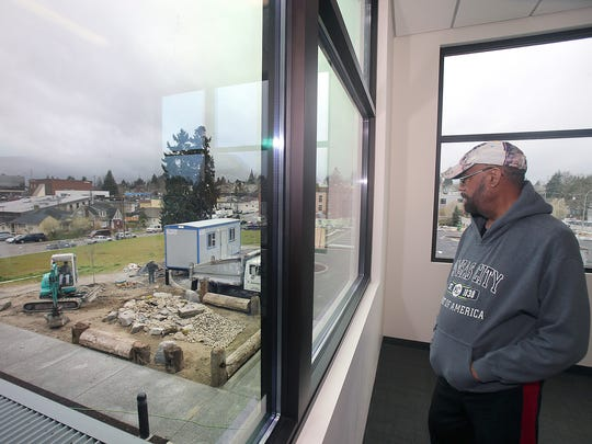 Bishop Larry Robertson looks down on the meditative rock garden in honor of his first wife Opal Robertson at the Marvin Williams Recreation Center at Eighth Street and Park Avenue in Bremerton.