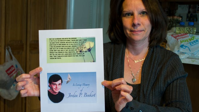Lisa Benkert shows a photo of her son, Jordan, who committed suicide in 2011. The boy's organs went on to save four people's lives across the country.