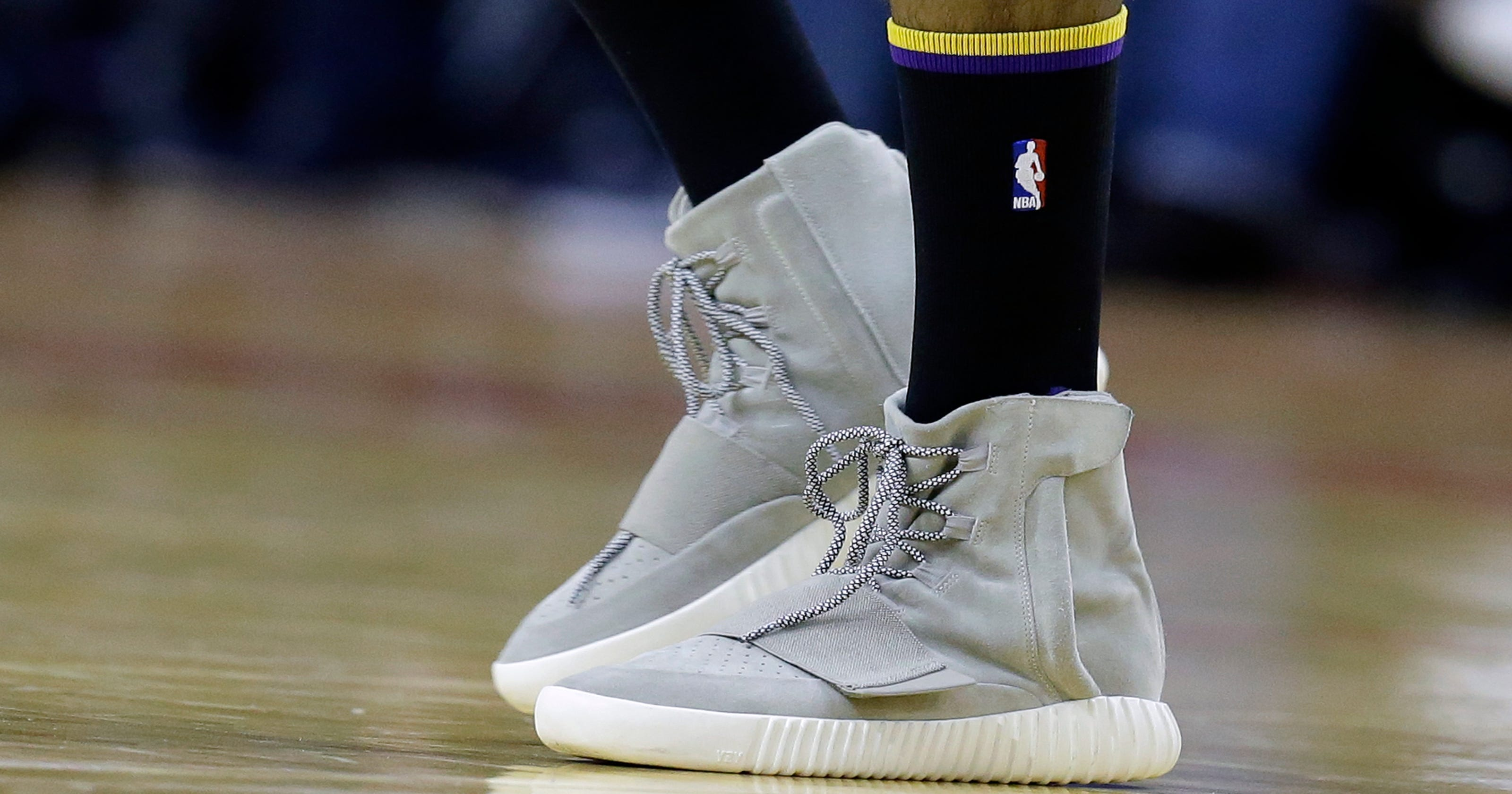 5bd497c7816e Swaggy P wears Kanye s lifestyle Yeezy shoes in game