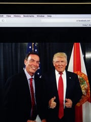 A photo on Craig T. Bouchard's Facebook page with him and, then-President-elect Donald Trump.