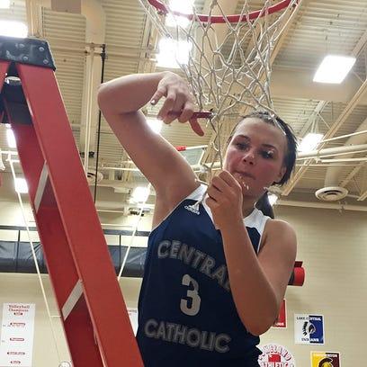 Central Catholic senior Emily Burks cuts down the net