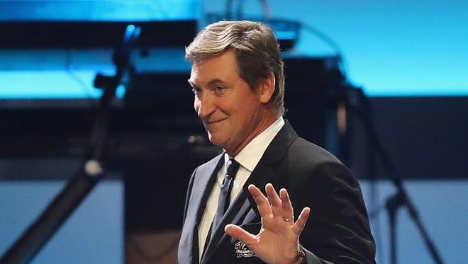 Hockey Hall of Famer Wayne Gretzky walks on stage during the NHL 100 presentation.