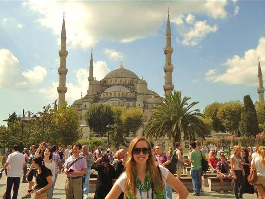 "Amanda Rewerts in front of the ""iconic blue Mosque"""