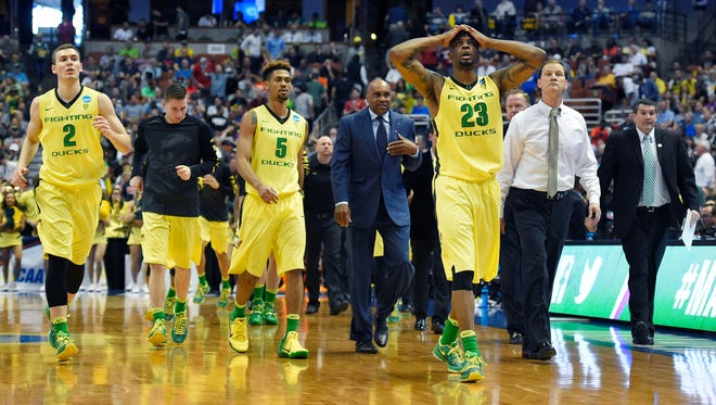 Members of the Oregon team walk off the court at half time in an NCAA college basketball game against Oklahoma in the regional finals of the NCAA Tournament, Saturday, March 26, 2016, in Anaheim, Calif.