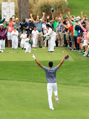 Tony Finau rolls his ankle as he celebrates his hole-in-one on the seventh hole during the Par 3 Contest prior to the start of the 2018 Masters Tournament at Augusta National Golf Club on April 4.