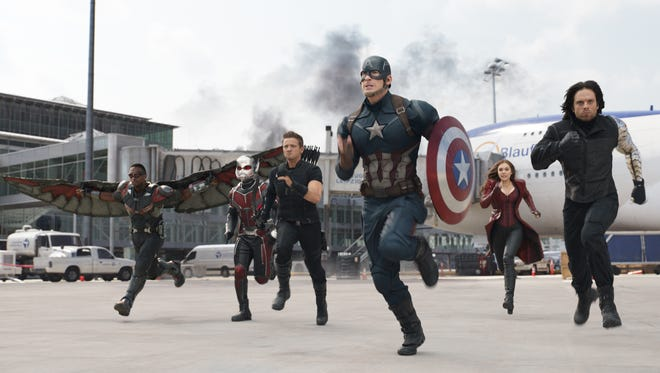 "In this image released by Disney, Anthony Mackie, from left,  Paul Rudd, Jeremy Renner, Chris Evans, Elizabeth Olsen and Sebastian Stan appear in a scene from ""Captain America: Civil War."""