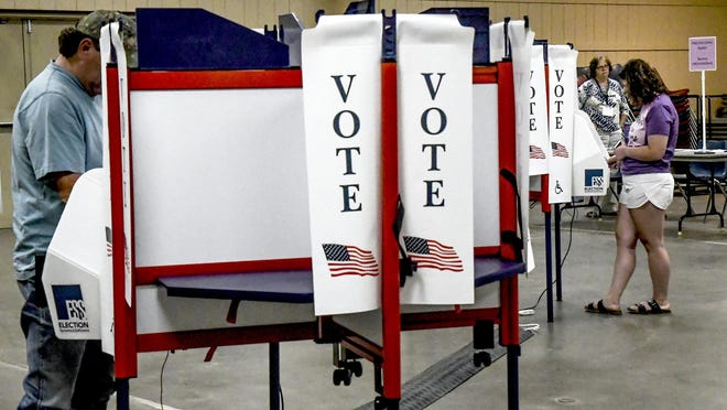 Local residents cast their ballots Tuesday at the Finney County Fairgrounds 4-H building during the 2020 primary election.
